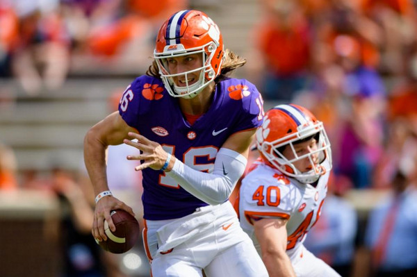 Former Cartersville and current Clemson quarterback Trevor Lawrence scrambles during Clemson's spring game on April 14.