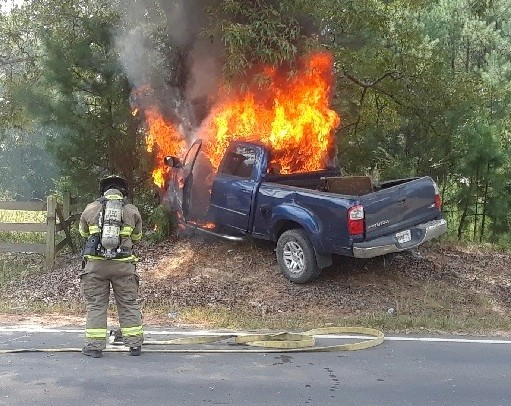 Three people trapped in a burning truck were rescued by an off-duty Cartersville Police officer in July.