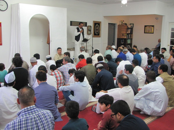 Nassim Baksh speaks at Masjid Quba Islamic Center of Cartersville's Eid al-Adha observance Tuesday morning.