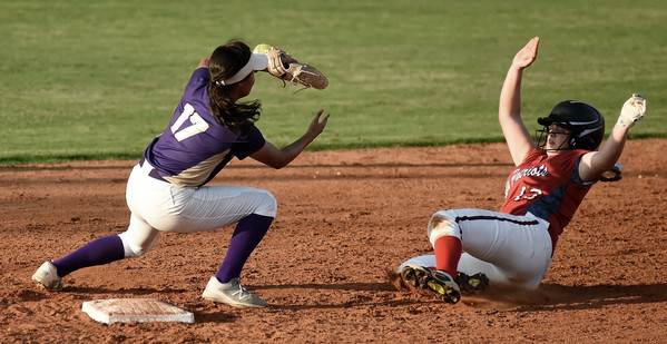 Cartersville junior shortstop Cio Seigler tries to take possession of a throw from the outfield to tag a Sandy Creek runner sliding into second base. Seigler finished 1-for-4 with an RBI in the Canes' 5-4 win.