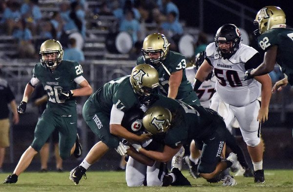 Adairsville's Kyle Martin (17) and Chandler Shankles (5) tackle a Chattooga ballcarrier during an Aug. 17 game at Tiger Stadium.