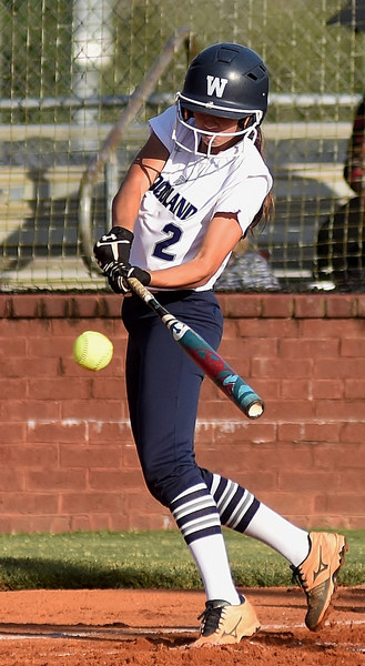 Woodland's Bella Carnes hits a first-inning single in an eight-inning, 2-1 win at home over first-place Carrollton Tuesday. Carnes scored both runs in the game for the Lady Wildcats.