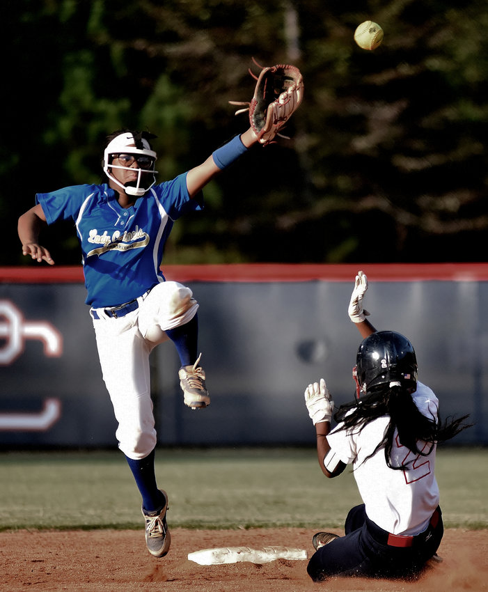 Cass freshman Eryn Lee leaps to snag a throw, as a Paulding County runner slides safely into second base, during Monday's game at Paulding County. In her return from injury, Lee finished 2-for-5 with three runs scored and two RBIs.