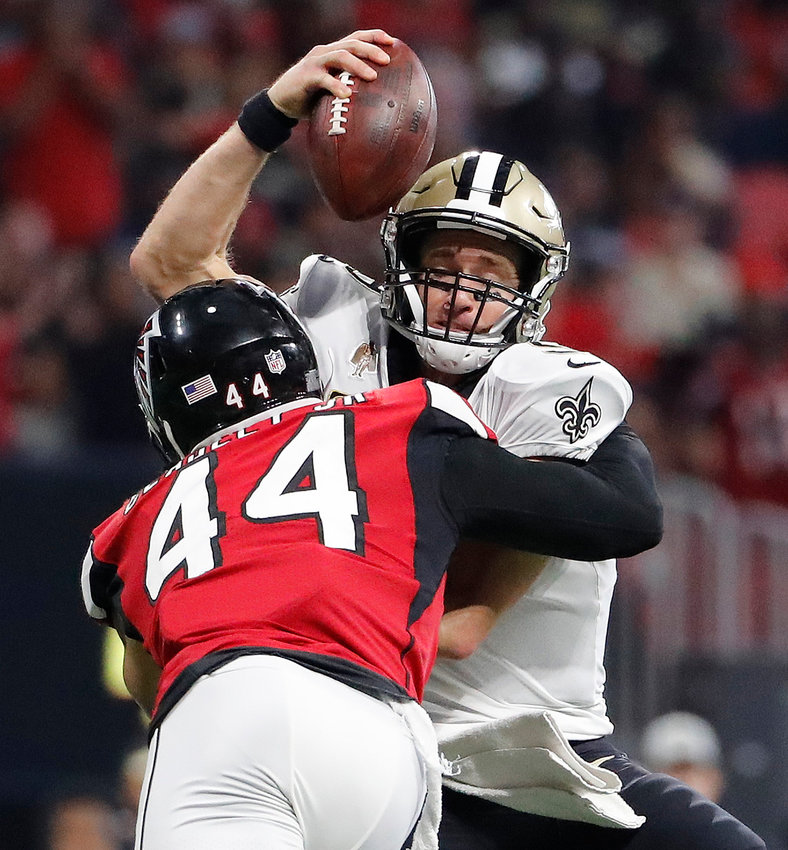 New Orleans Saints quarterback Drew Brees is sacked by Atlanta Falcons linebacker and Adairsville product Vic Beasley Jr. during the second half of a game Sunday in Atlanta.