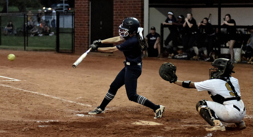 Woodland's Caroline Higdon hits a three-run double during the second game of Tuesday's doubleheader at Carrollton. The Wildcats split the games to force Game 3 in the Region 7-AAAAA championship series.