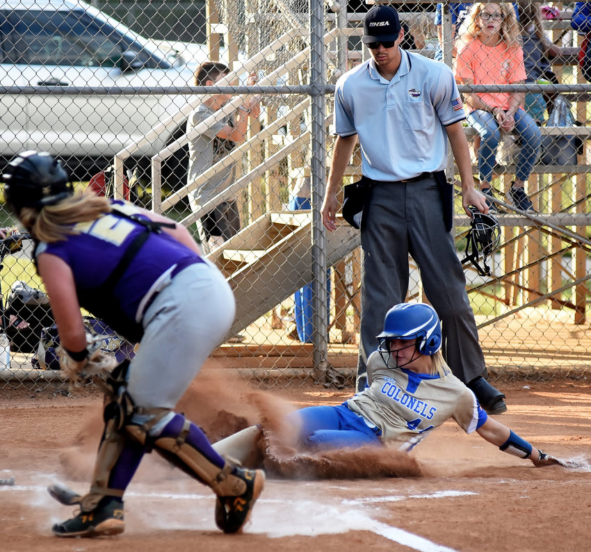 Cass freshman Kylee Hembree slides safely into home following a hit from Haley Owens during Tuesday's Region 7-AAAAA Tournament game against Hiram at East Paulding.