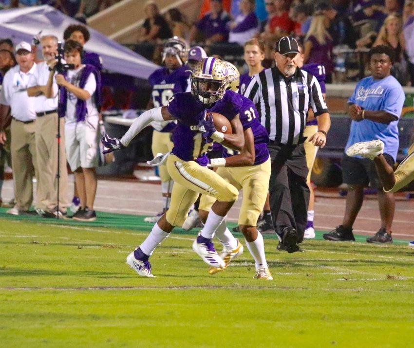 Dadrian Dennis runs after the catch for a touchdown during a game last week against Central-Carroll at Weinman Stadium. The Canes will take on LaGrange tonight back at home.