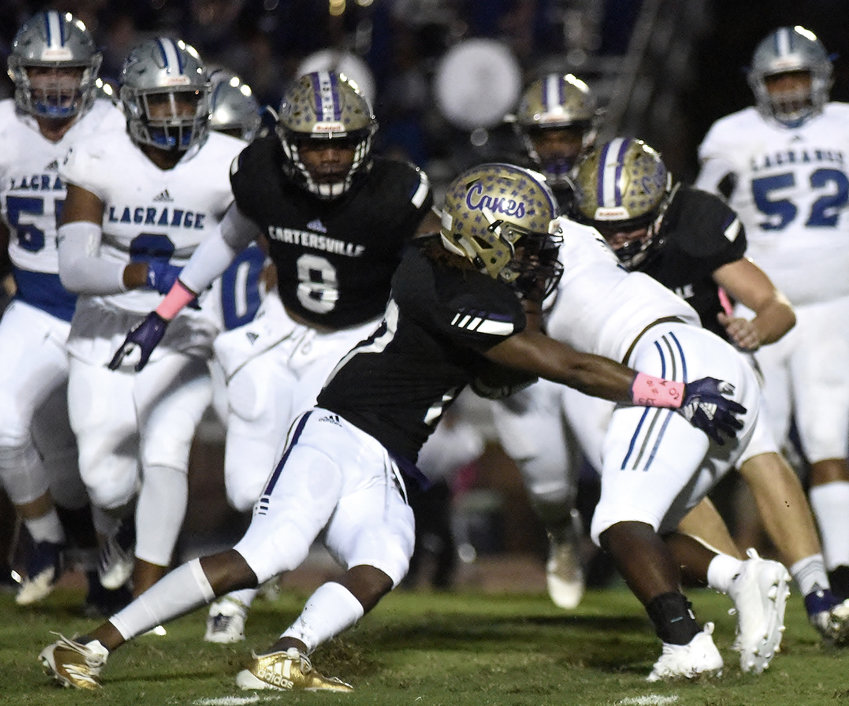 The Cartersville defense converges on a LaGrange ballcarrier during the Canes' 45-7 win Friday at Weinman Stadium.