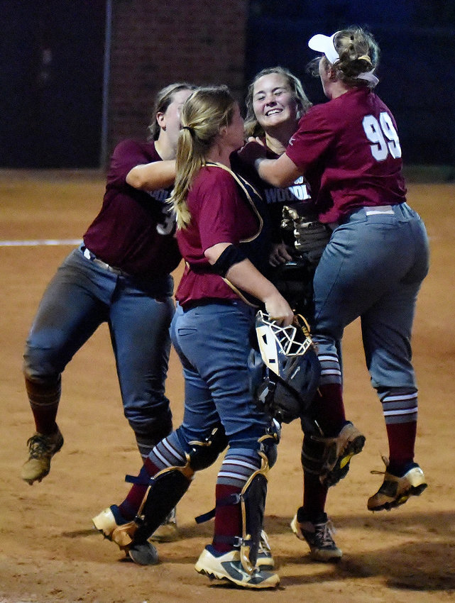 Woodland High softball players celebrate in the pitcher's circle after winning the region championship last week against Carrollton. Woodland will open the state playoffs at home today against North Springs.
