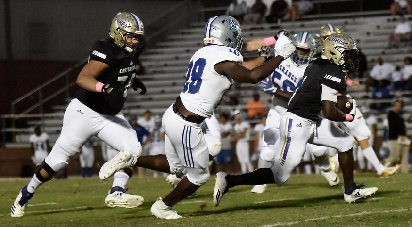 Cartersville senior Marcus Gary bursts through a hole during Friday's 45-7 home win over LaGrange at Weinman Stadium. This week, the Canes will hit the road to face Sandy Creek.