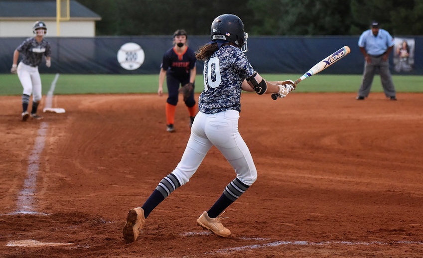 Woodland's Morgan Bailey singles through the right side of the infield to score Morgan Cooper from third base in Game 2 of Thursday's home doubleheader against North Springs. The Wildcats swept the Spartans in the first round of the Class 5A state playoffs.