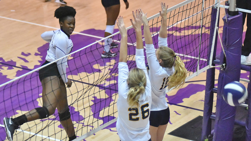Cartersville's Nedu Evans spikes the ball past the Troup County defense during Thursday's semifinal match in the Region 5-AAAA tournament. Evans totaled 25 kills between the semifinals and the finals, as the Canes won a third straight region title.
