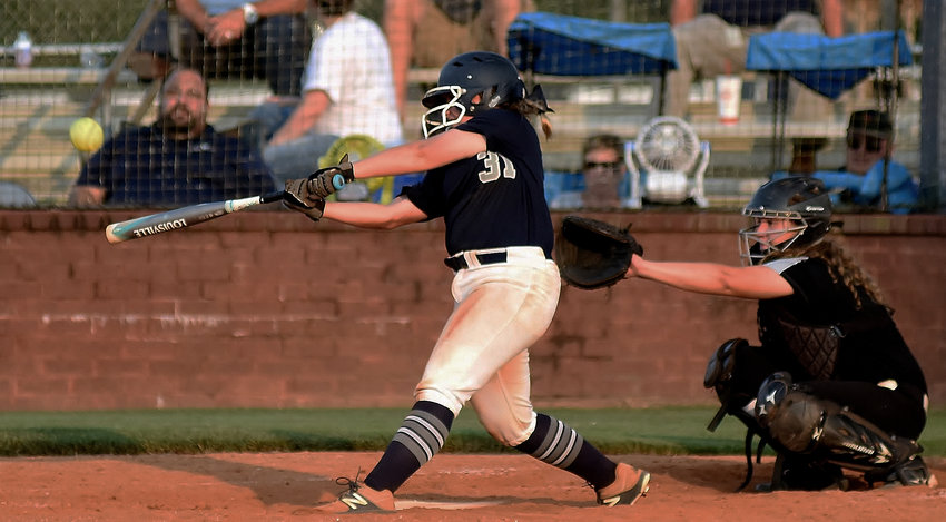 Woodland's Kendyl Hardin hits a home run during an Aug. 13 game at home against East Paulding.