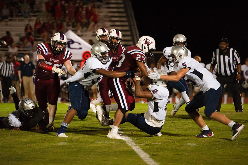 Woodland junior running back Demarcus Williams runs through the tackles of Paulding County defenders during a game on?Sept. 14 at?Wildcat Stadium. Woodland takes on Villa Rica Friday on the road.