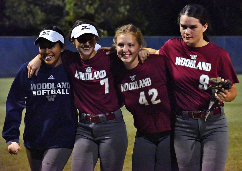 Woodland seniors, from left, Sarah Baynard, Jordan Duck, Skylar Chappell and Caroline Higdon walk off Woodland Field after the final game of their high school careers. The Wildcats were swept by Buford in the second round of the Class 5A state playoffs Wednesday.