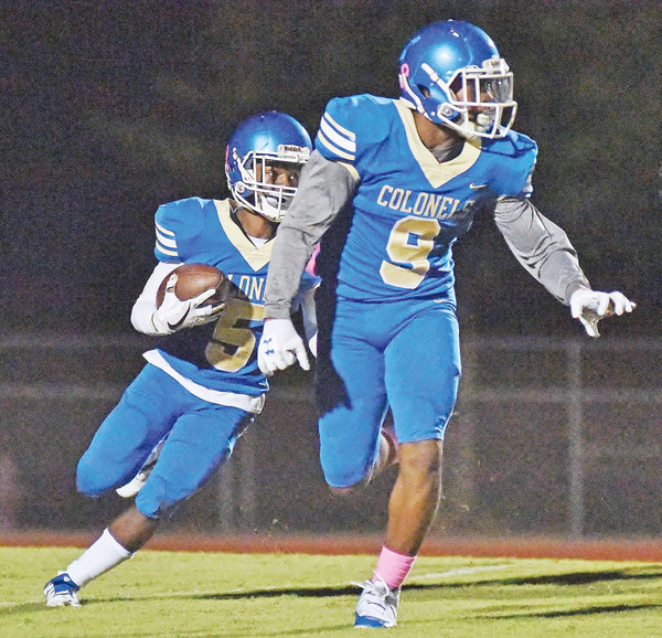 Malik Grimes runs behind Thomas Gilliam during a game on Oct. 13 against East Paulding at Doug Cochran Stadium. The Colonels take on Kell Friday on the road.