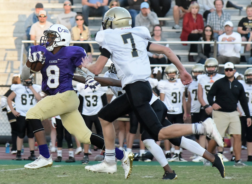 Cartersville Middle School's Malachi Jeffries breaks free from the Calhoun defense for a 53-yard touchdown run during the second half of the Bartow Gordon Middle School Athletic Association championship game Wednesday at Weinman Stadium.