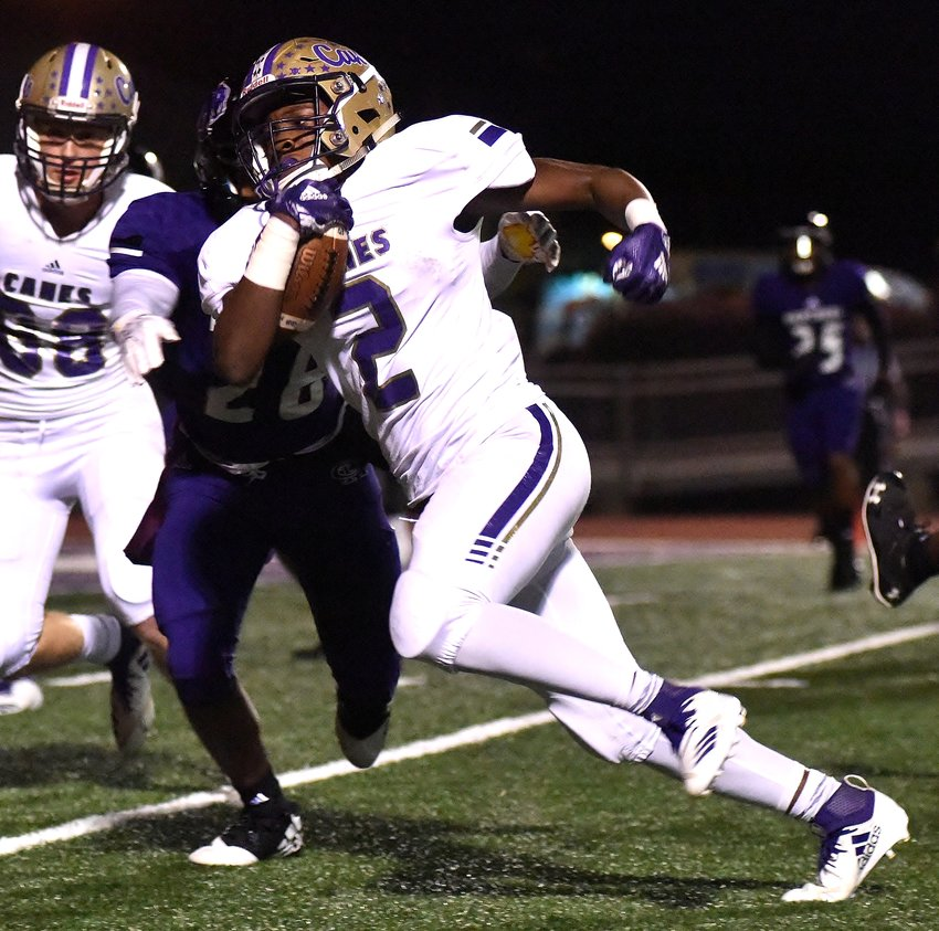 Cartersville's Quante Jennings carries the ball during Friday's game at Chapel Hill. Jennings scored two touchdowns as the Canes moved to 9-0 on the year with their 51-0 win.