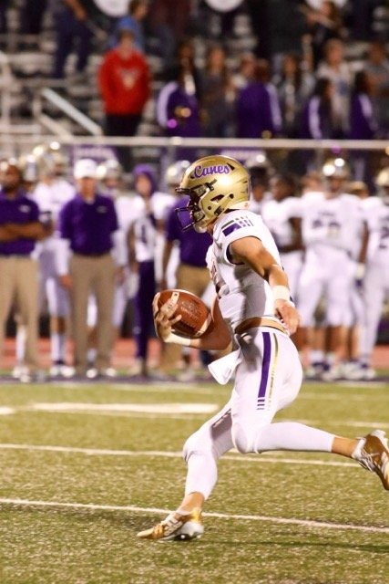 Cartersville junior quarterback Tee Webb carries the ball upfield during Friday's 51-0 win over Chapel Hill. Webb completed 12 of 20 passes for 245 yards and three touchdowns in the road victory.