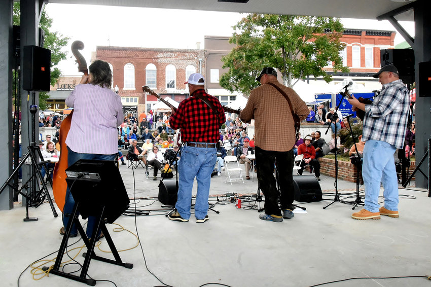 From left, Mindy Rakestraw, Ronnie Wilbanks, Brad Payne and Brad Burel of Cartersville's Old Mill Road Band entertain on the Depot Stage Saturday at the 2018 Cartersville Bluegrass & Folk Festival.