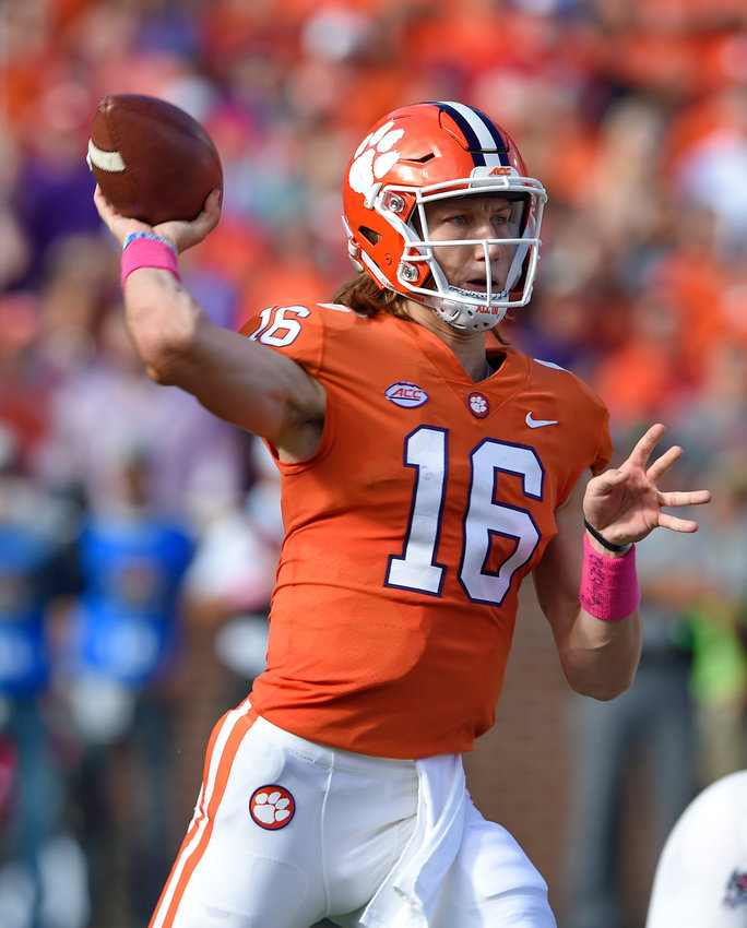 Clemson quarterback Trevor Lawrence throws a pass during the first half of Saturday's game against North Carolina State in Clemson, South Carolina.