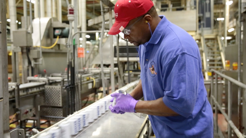 An Anheuser-Busch employee checks canned water at the facility in Cartersville.