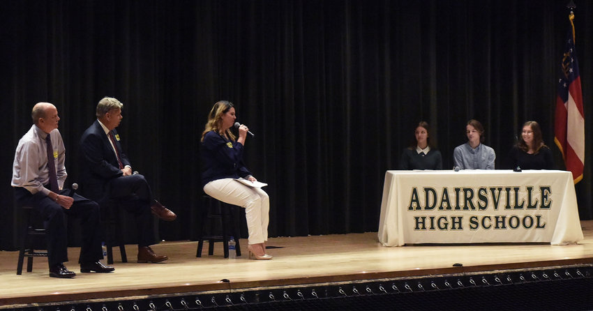 Candidates for state House District 14, from left, Mitchell Scoggins, Ken Coomer and Nickie Leighly answer questions posed by Adairsville High AP government students, from left, Hannah Turner, Jack Bates and Bailey Wilson at a town hall forum in the AHS auditorium Friday.