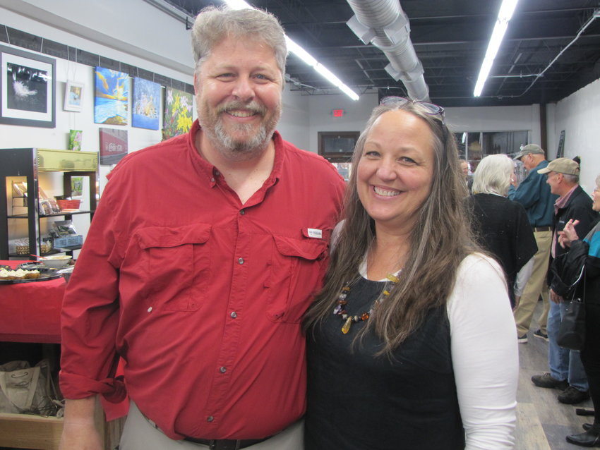 Joe and Valerie Millsaps celebrate the grand reopening of Wall to Wall Frames in downtown Cartersville Friday afternoon.