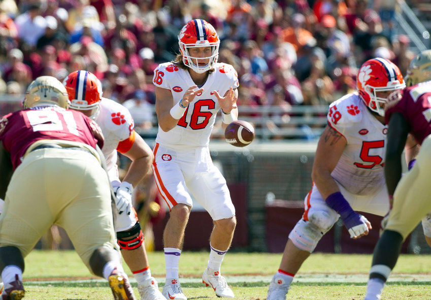 Clemson quarterback Trevor Lawrence takes a snap in the first half of the game against Florida State in Tallahassee, Florida, Saturday.