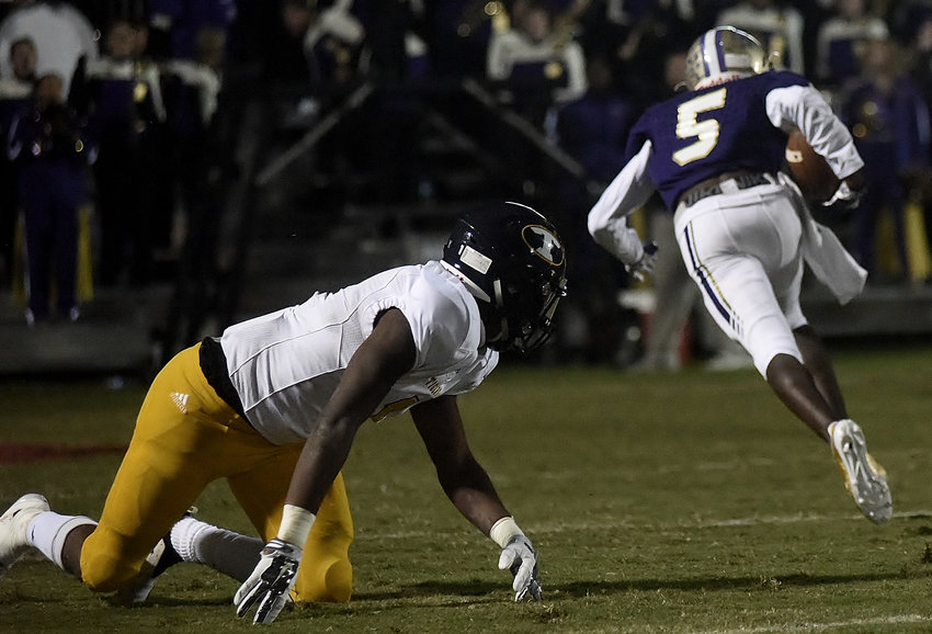A Troup County defender can only watch as Cartersville sophomore Devonte Ross runs into the end zone on a 46-yard touchdown in Cartersville's 43-10 for the Region 5-AAAA title Friday night at Weinman Stadium.