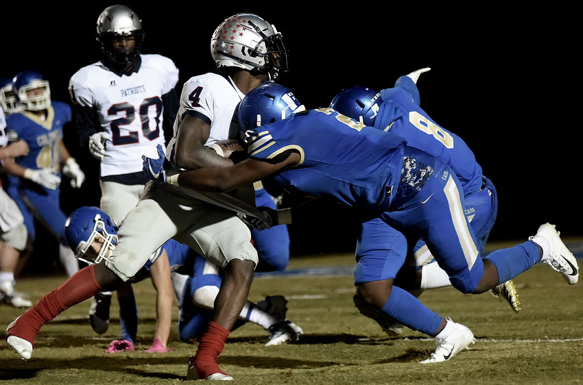 Cass senior Rodney Richards tackles a Paulding County ball-carrier during Friday's game at Doug Cochran Stadium. The Colonels fell to the Patriots, 17-14.
