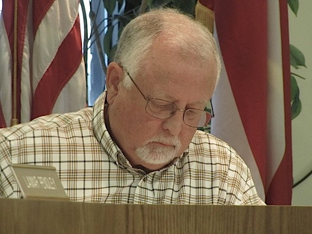 City of Cartersville Planning Commission Chairman Lamar Pinson reviews the docket at Tuesday evening's meeting.