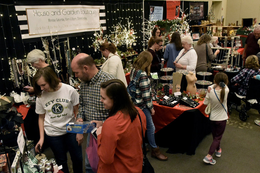 """More than 2,000 early Christmas shoppers attended the Christmas Village Friday and Saturday at the Clarence Brown Conference Center in Cartersville. According to event coordinator Karon Mauney, the Christmas Village, featuring 82 booths, was """"...a great opportunity for small businesses to showcase their products and for our guests, a wonderful time to get some holiday shopping done early."""""""