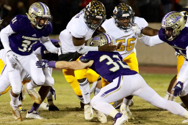 Cartersville linebacker Harrison Allen tackles a Troup County player during last Friday's home game. The Canes host Stephens County at 7:30 Friday night in the first round of the Class 4A state playoffs.