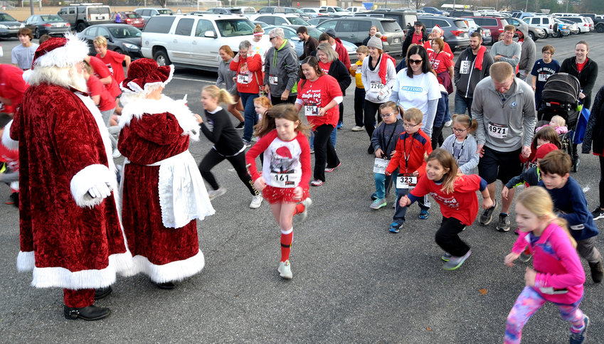 Runners participate in last year's Cartersville Jingle Jog 5K & 1K Fun Run, which will return Dec. 1 as a fundraiser for Christian League for Battered Women.