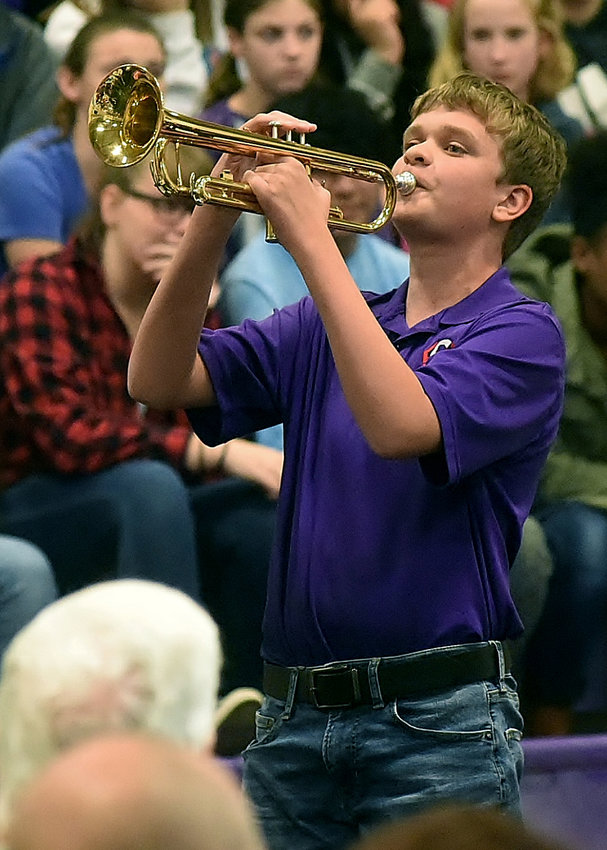 """Cartersville Middle School eighth-grader Max Langston plays """"Taps"""" Thursday morning at the school's annual Veterans Day ceremony."""