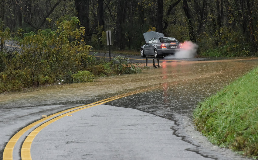 Monday's heavy and steady rains caused flash flooding on many area roads, as seen here on Parr Wade Road in Cartersville.