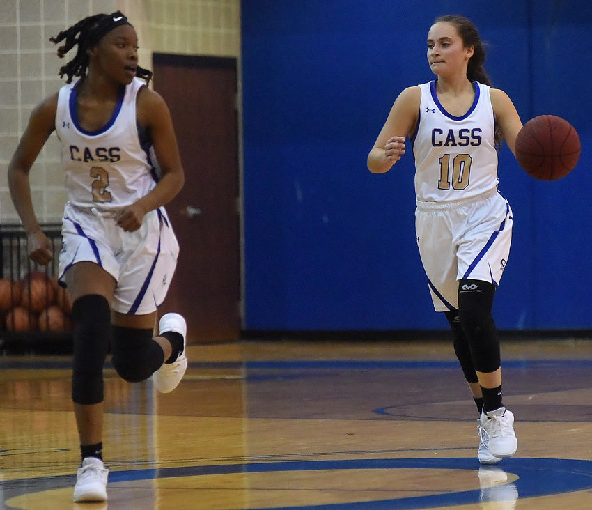 Cass senior Amber Brittian brings the ball upcourt alongside sophomore teammate Londaisha Smith during Tuesday's regular-season opener against Cumberland Christian at home. Brittian led the Colonels with 14 points, while Smith added 11 in the 60-30 win.
