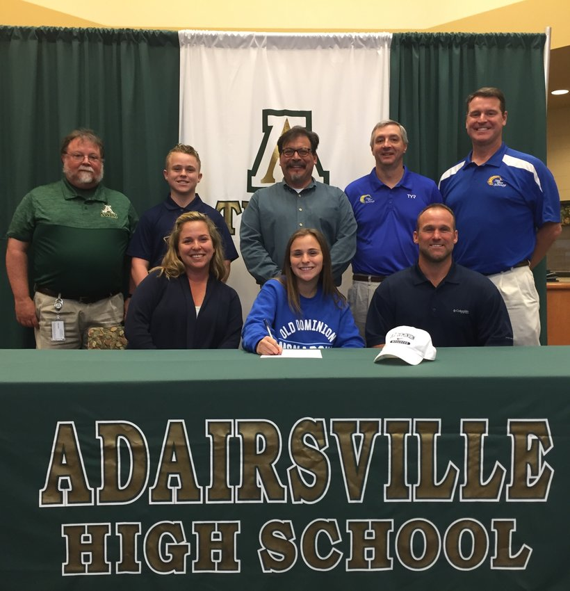 Adairsville High senior Rylee Moss signed her national letter of intent to swim at Old Dominion Wednesday in the school's media center. On hand for the signing were, front row, from left, Maurni Moss, mother; Chris Moss, father; back row, Lance Hall, AHS swim coach; Jackson Moss, brother; Shawn Williams, AHS swim coach; Gene Paliskis, club swim coach; and Jim McGinnis, club swim coach.