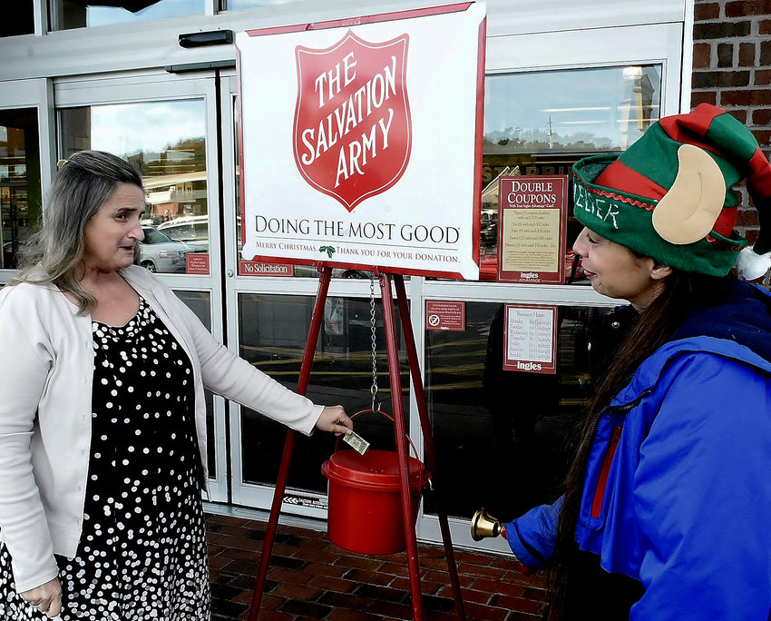 Bell ringer Lisa Jackson, right, greets Deborah Andrews of Cartersville at The Salvation Army's Red Kettle at the Ingles on Joe Frank Harris Parkway last year.