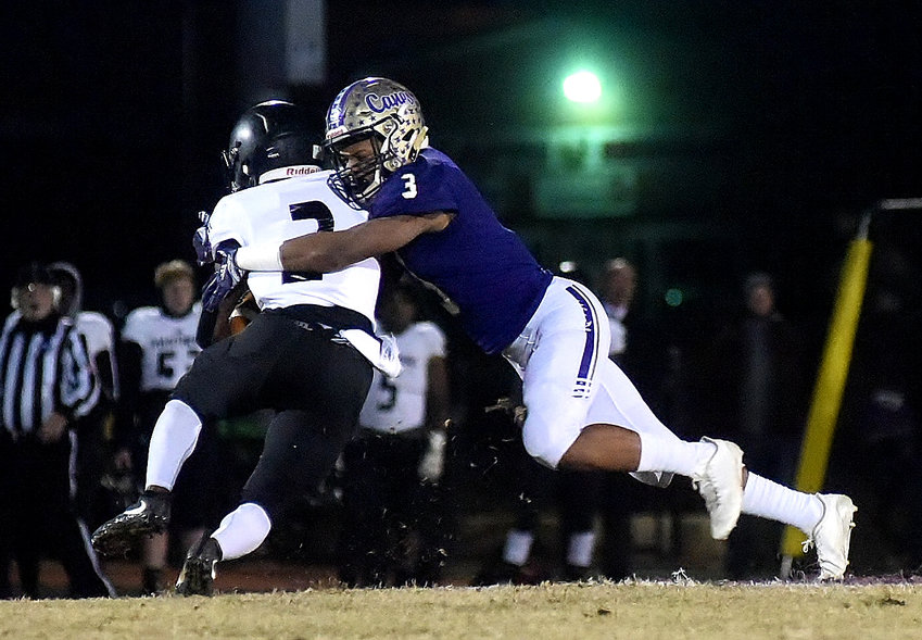 Cartersville sophomore Evan Slocum tackles a Ridgeland ballcarrier during Friday's Class 4A state second-round playoff game at Weinman Stadium. The Canes won 41-7 to set up a quarterfinal meeting on the road at Baldwin — the same school the Cartersville boys basketball team visited in the state quarterfinals earlier this year.
