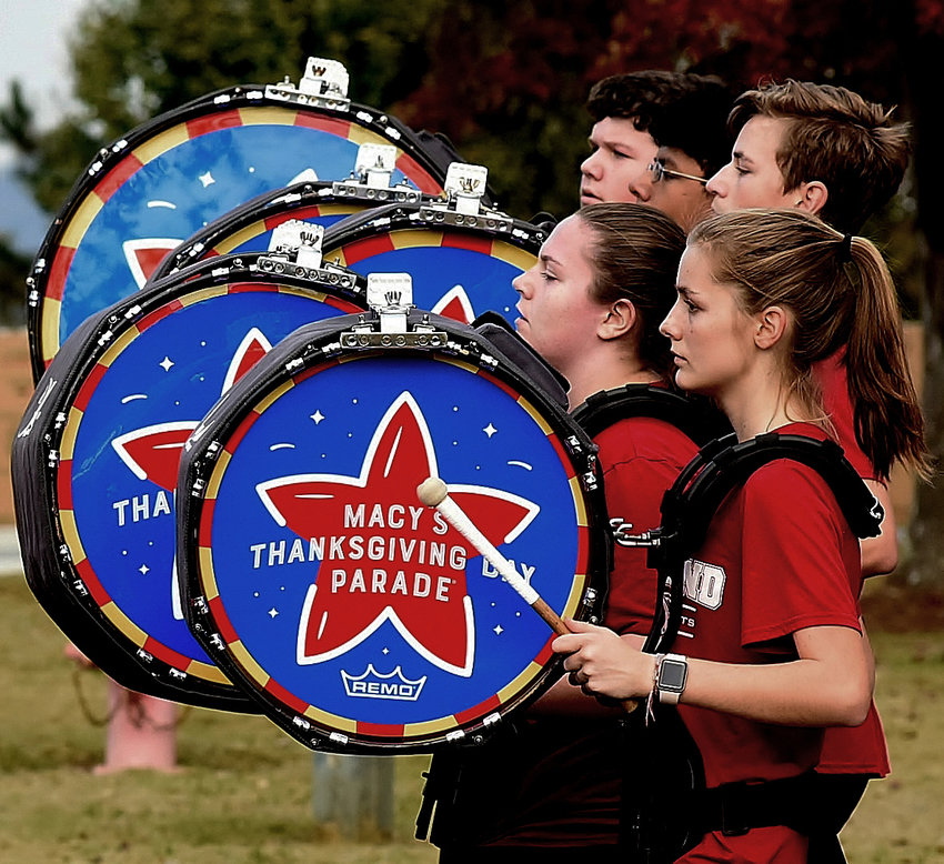 With their drums decorated for Thursday's Macy's Thanksgiving Day Parade, the bass drummers in the Woodland High School band rehearse one last time Sunday before leaving for New York Tuesday morning.