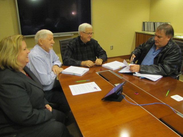 From left, Bartow-Cartersville Joint Development Authority representatives Melinda Lemmon, Ronnie Evans, James Jarrett and Keith Lovell conclude the paperwork authorizing a bond resolution for the next phase of Toyo Tire expansion in White.