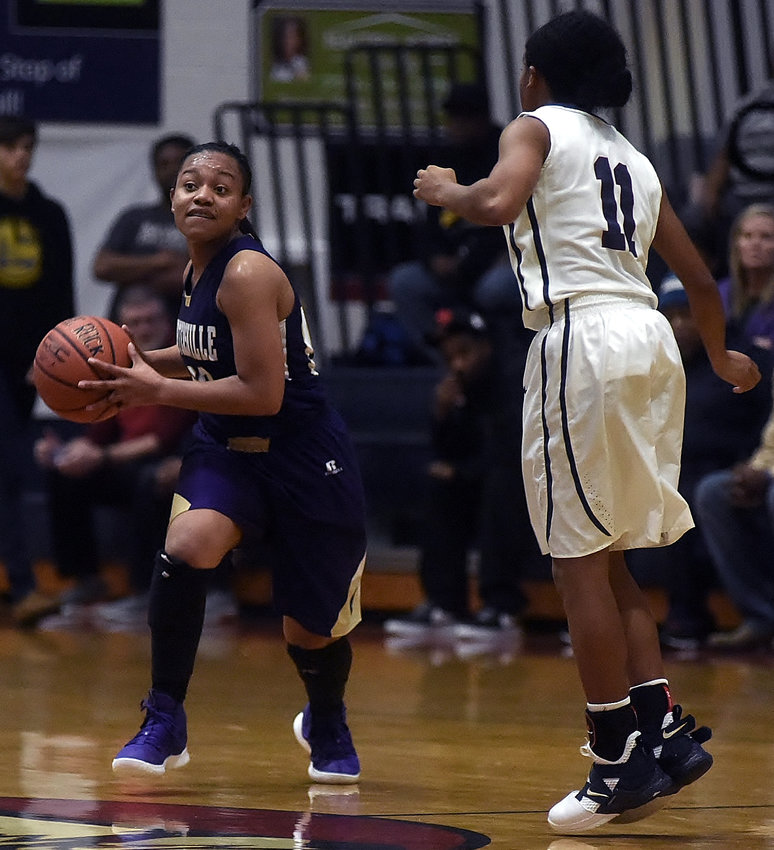 Cartersville senior A'mya Davis looks to pass while being defended by Woodland's Madgie Robinson during Saturday's game.