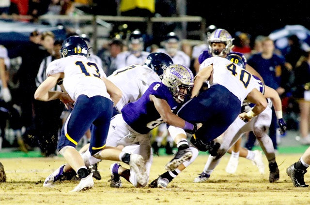 Cartersville senior defensive end Bobby Harris tackles a Marist ballcarrier during Friday's win.