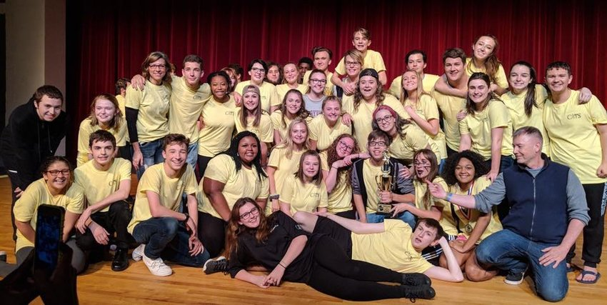 """The cast and crew of Woodland High School's one-act play """"Once on This Island"""" show off the first-place trophy they won at the regional competition in late October."""