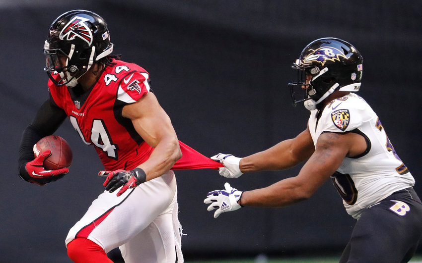 Baltimore Ravens running back Kenneth Dixon (30) tries to stop Atlanta Falcons defensive end and Adairsville native Vic Beasley (44) after a fumble recovery during the first half of a game Sunday, Dec. 2, in Atlanta. Beasley recorded a sack in this Sunday's loss to Green Bay.