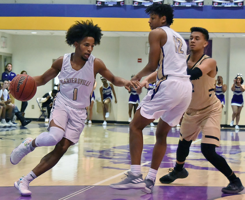 Cartersville senior Perignon Dyer (1) drives to the basket during the first half of Friday's home opener against Calhoun. Dyer finished with 26 points, 18 of which came after a halftime change to bright yellow shoes, and Amarai Orr (12) added 17 points in a 76-73 win.