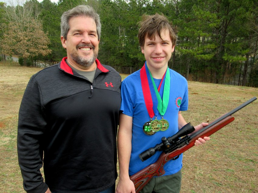 4-H Shooting Awareness, Fun and Education (SAFE) program coach Scott Drexler, left, with shooting protege (and 17-year-old son) Joshua Drexler.