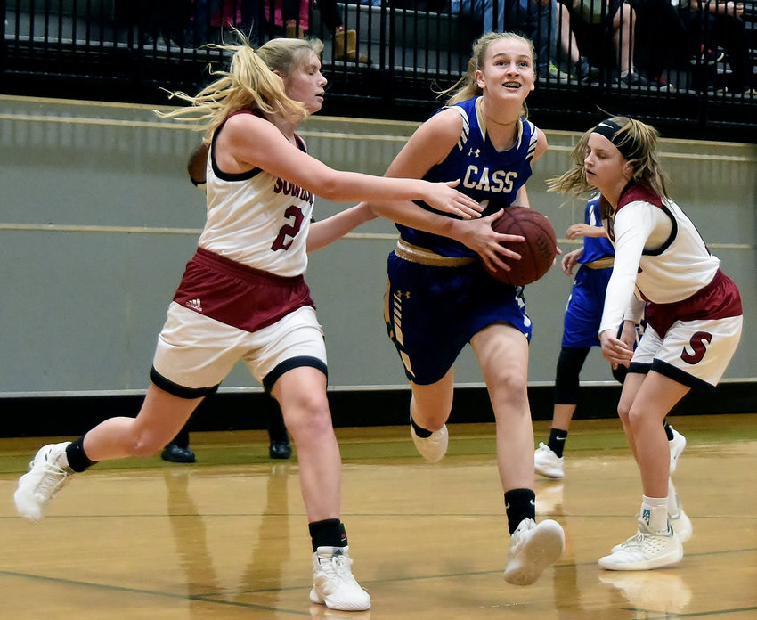 Cass freshman Claire Davis drives to the basket against Southside (Alabama) en route to converting a layup during Saturday's championship game of the Adairsville Christmas Clash. Davis finished with 11 points in the Colonels' 42-40 win.